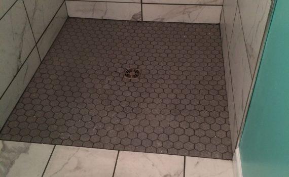 Hexagon tile shower floor curbless shower